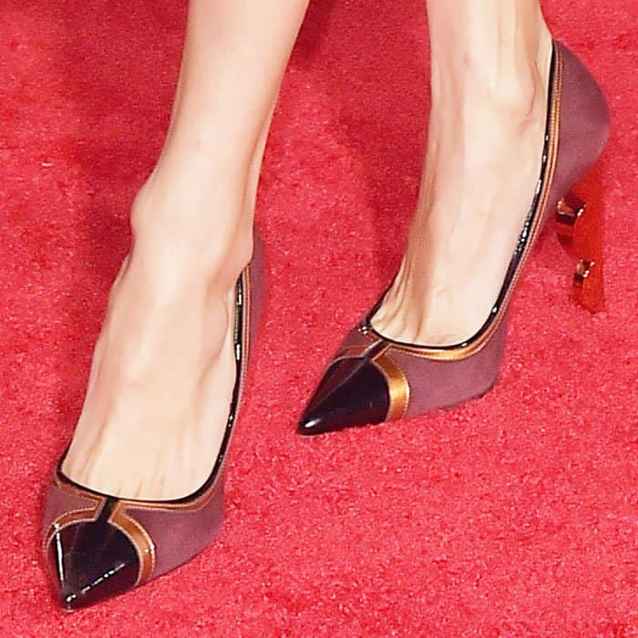 "Nina echoed plum colors with a pair of Nicholas Kirkwood ""Nola"" pumps"