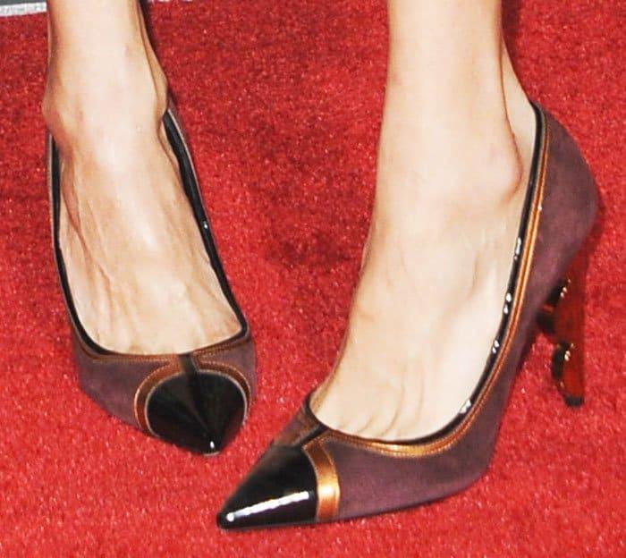 "Nina echoed plum colors with a pair of Nicholas Kirkwood ""Nola"" pumps"