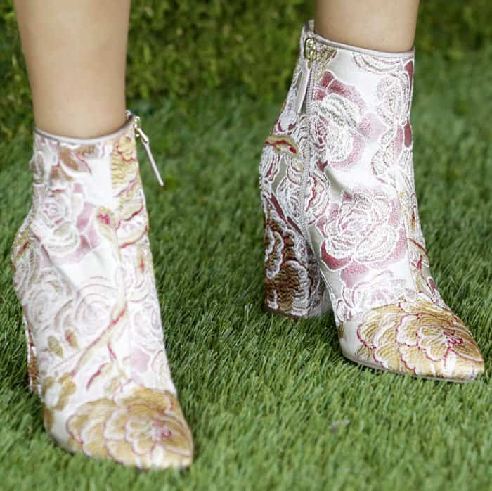 "Not your typical polo shoes: Victoria picked out a pair of jacquard print ""Savitra"" boots from Nine West"
