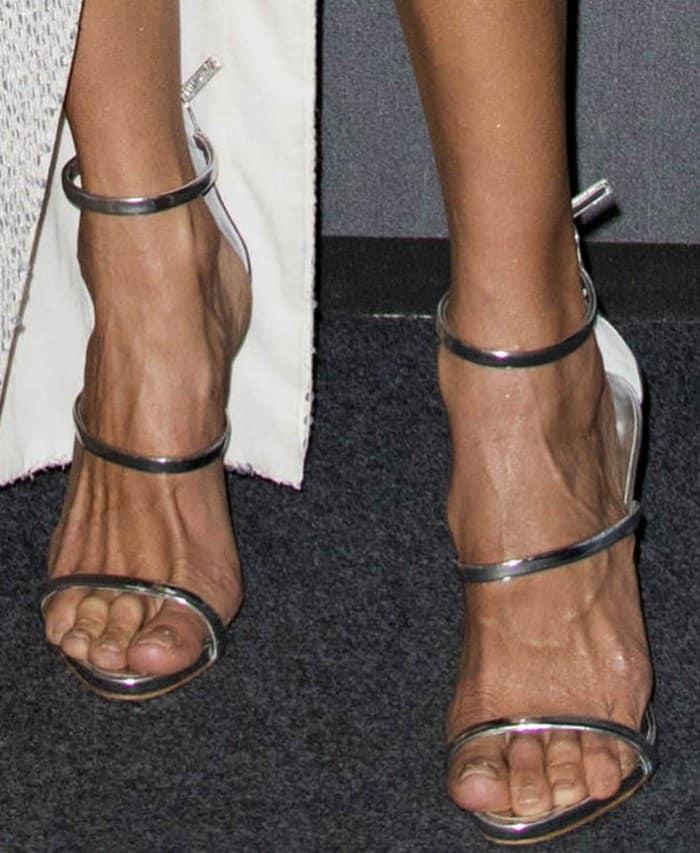 "Alessandra Ambrosio wearing Giuseppe Zanotti ""Harmony"" sandals in mirrored silver patent leather at the 2017 amfAR Milano gala"