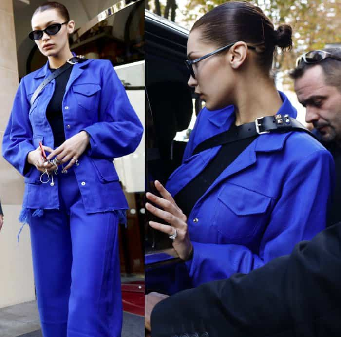 "Bella Hadid wearing a blue Marques'Almeida structured jacket, matching wide-legged pants, and Roberi & Fraud ""Betty"" sunglasses while leaving her hotel in Paris"