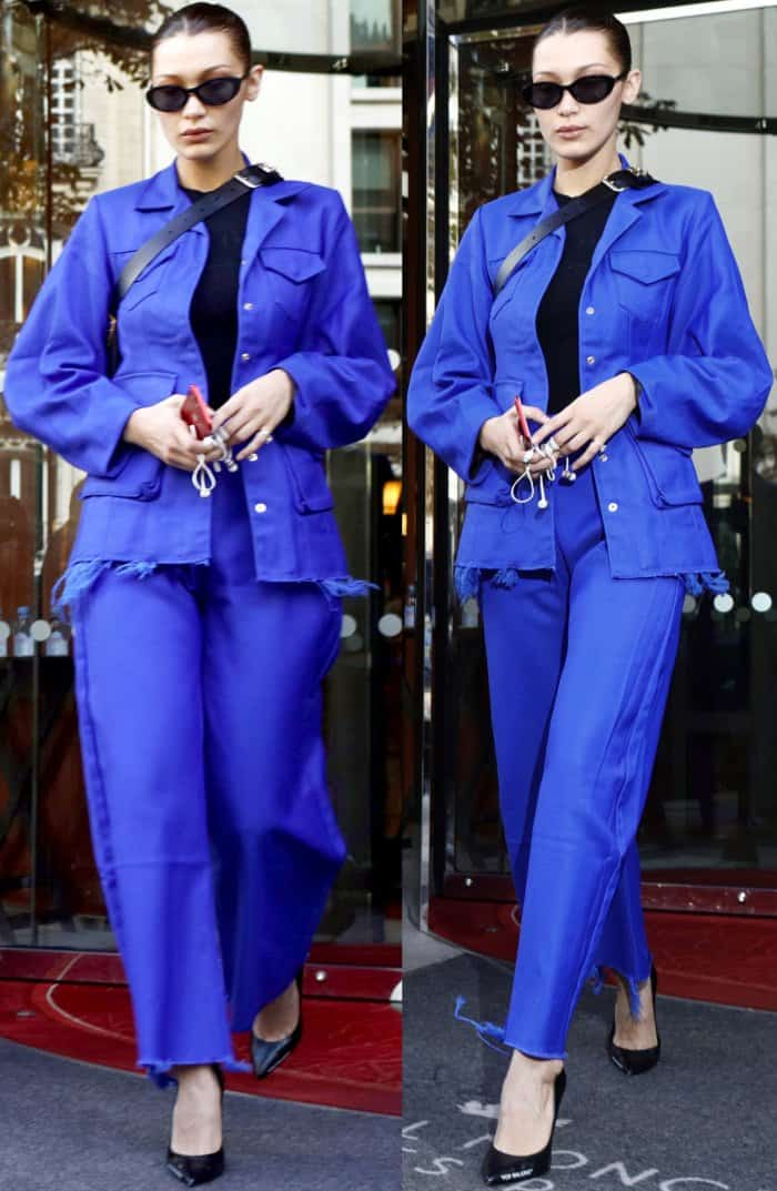 "Bella Hadid wearing a blue Marques'Almeida structured jacket, matching wide-legged pants, and Off-White ""For Walking"" black leather pumps while leaving her hotel in Paris"