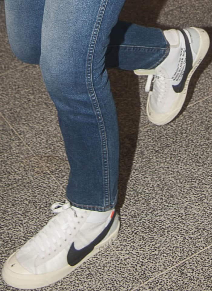 """Bella Hadid wearing Off-White for Nike """"Blazer Mid"""" sneakers at the Milan-Malpensa Airport"""