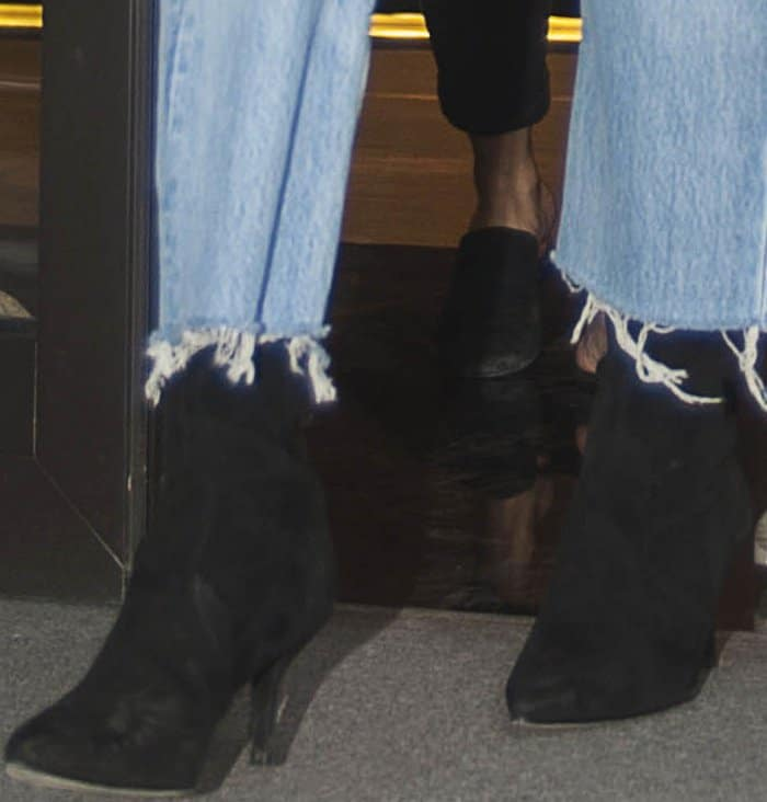 """Bella Hadid wearing Stuart Weitzman """"Cling"""" booties in black suede while out and about in Milan"""