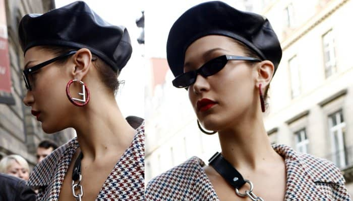 "Bela Hadid wearing a Claudia Li Fall 2017 oversized checked blazer, a Dior black leather beret, and Fendi ""F Is Fendi"" earrings while out and about in Paris"