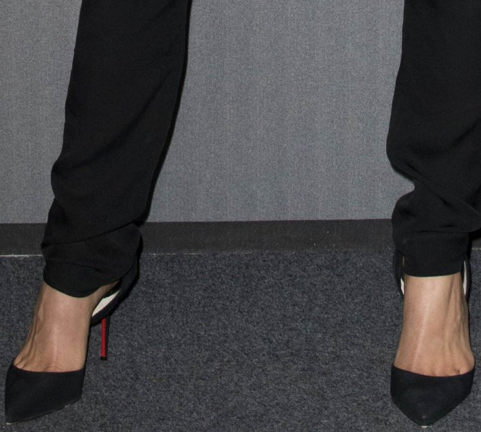 Georgia Fowler wearing Christian Louboutin pointy-toe pumps at the 2017 amfAR Milano gala