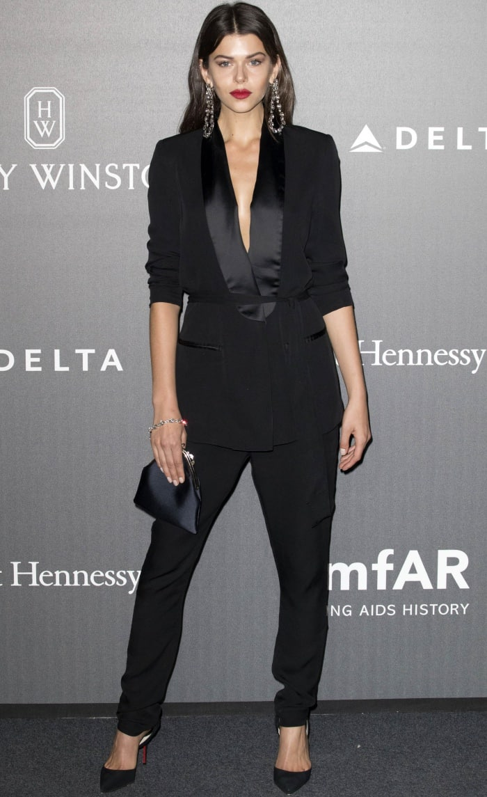 Georgia Fowler wearing a black power suit and Christian Louboutin pointy-toe pumps at the 2017 amfAR Milano gala