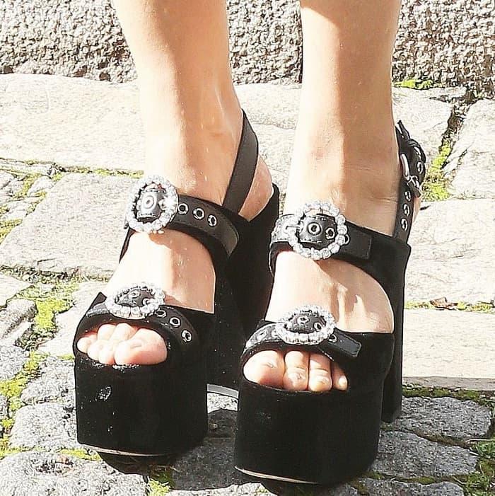 Maggie Gyllenhaal wearing Miu Miu buckled platform sandals at the Miu Miu Spring/Summer 2018 fashion show during Paris Fashion Week