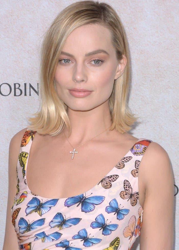 """Margot Robbie wearing a Versace dress emblazoned with butterflies at the """"Goodbye Christopher Robin"""" New York special screening"""