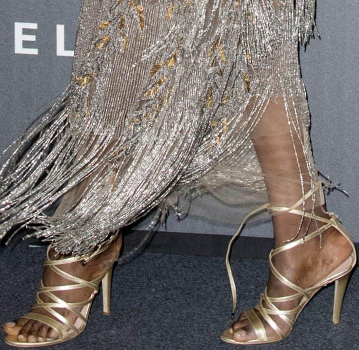 Maria Borges wearing strappy heels at the 2017 amfAR Milano gala