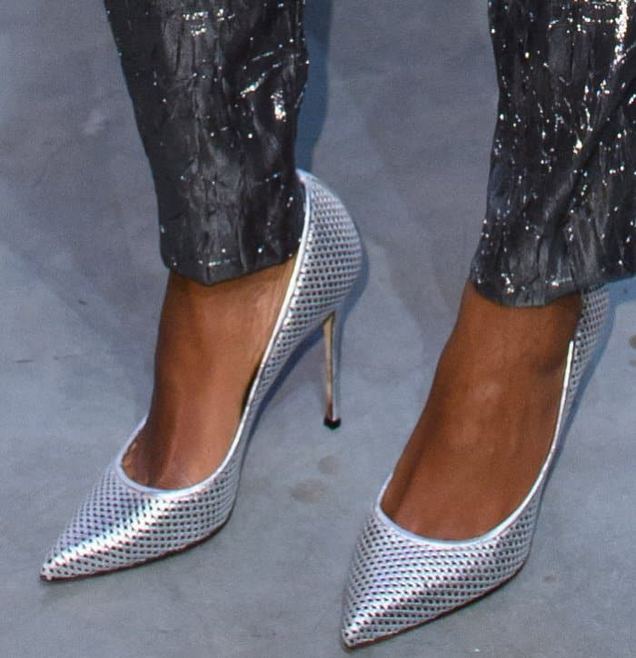 """Naomie Harris wearing silver pointy-toe pumps at the Michael Kors """"Sexy Ruby"""" fragrance launch in London"""