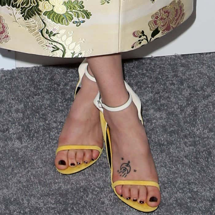 "Riley Keough wearing Calvin Klein 205W39NYC ""Camrin"" winged suede ankle-strap sandals at Elle's 24th Annual Women in Hollywood Celebration"