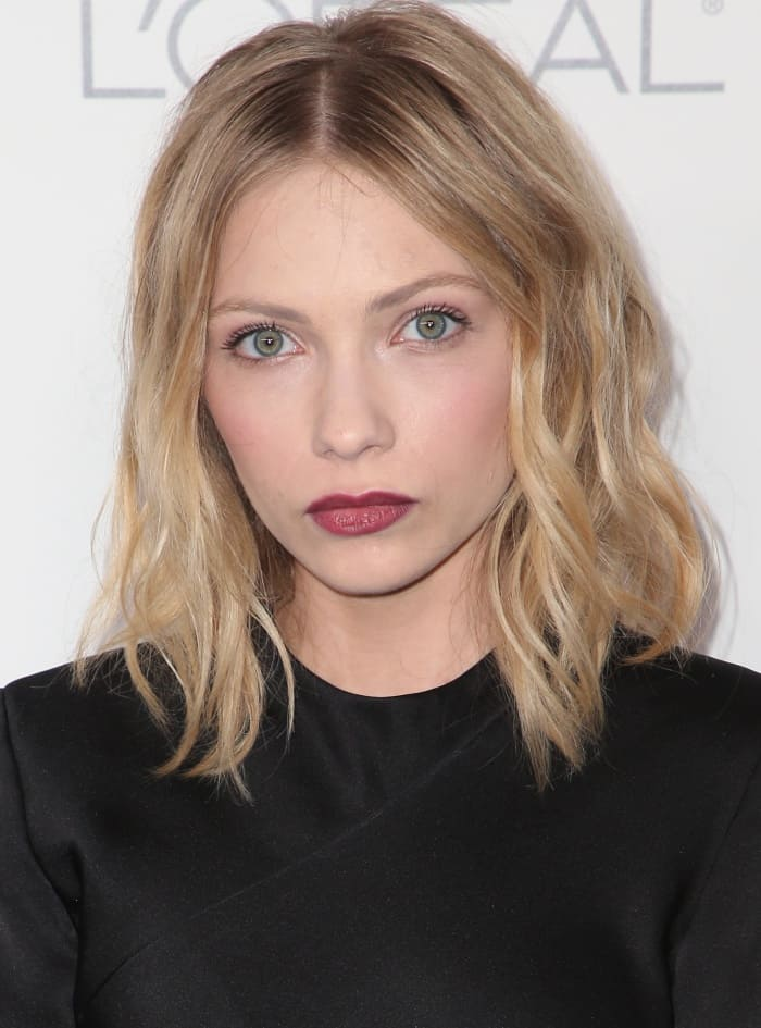 Tavi Gevinson capped it off with tousled waves and a dark red pout