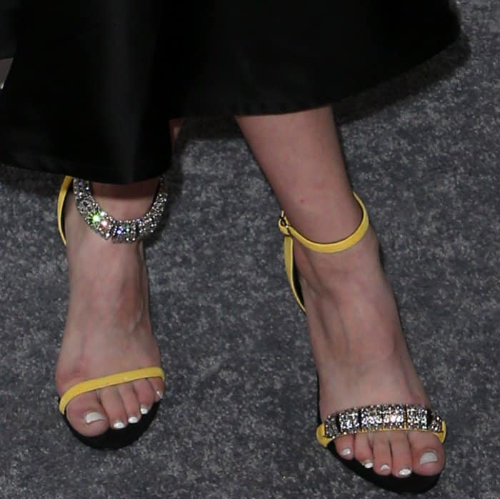 "Tavi Gevinson added a pop of color to her look via her yellow ""Camelle"" sandals"
