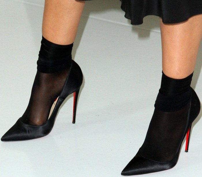 Tessa Thompson wearing black pointy-toe pumps with sheer black socks at the Hammer Museum 15th Annual Gala in the Garden