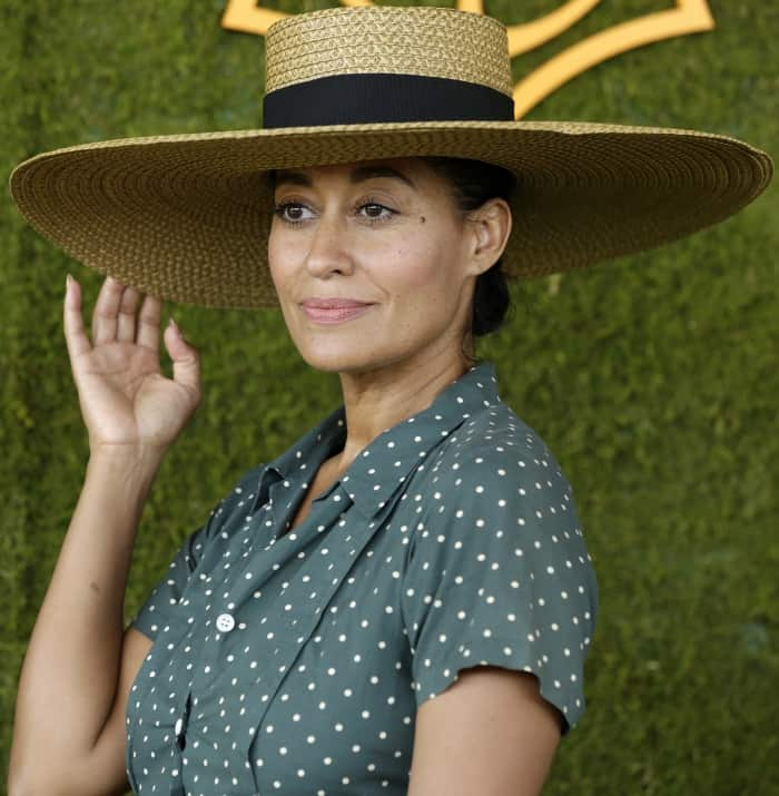 Tracee Ellis Ross wearing an Agnes B top and a wide-brimmed hat at the 8th Annual Veuve Clicquot Polo Classic