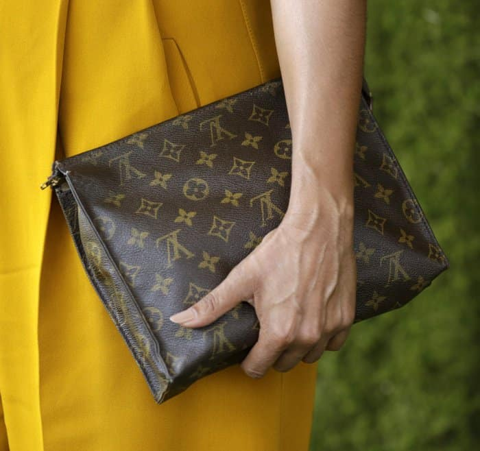 Tracee Ellis Ross carring a Louis Vuitton logo clutch at the 8th Annual Veuve Clicquot Polo Classic