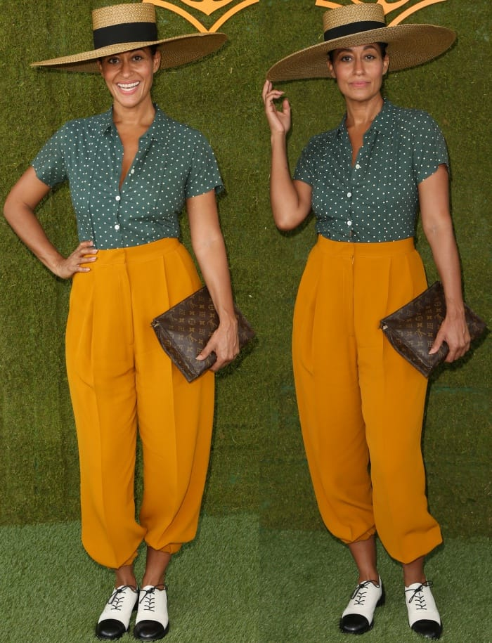 "Tracee Ellis Ross wearing an Agnes B top, Celine mustard yellow pants, and Stuart Weitzman ""Marlon"" loafers at the 8th Annual Veuve Clicquot Polo Classic"