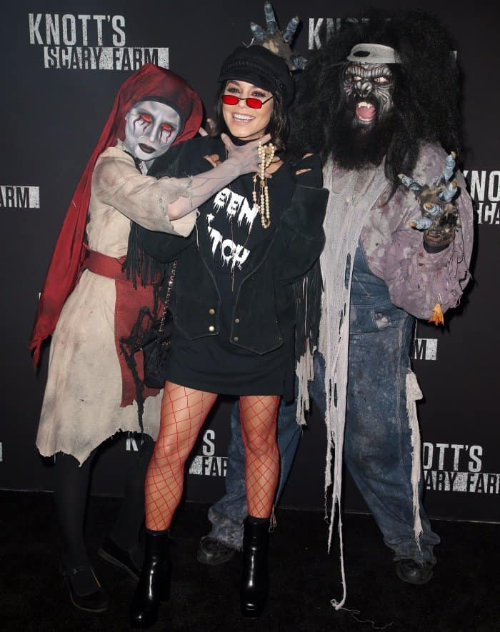 Vanessa Hudgens posing with actors in impressive costumes at Knott's Scary Farm in Buena Park