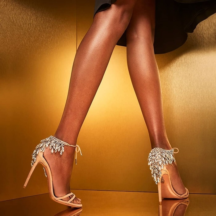 This glamorous pair has been crafted in Italy from smooth blush suede and finished with slender crossover straps and ankle ties