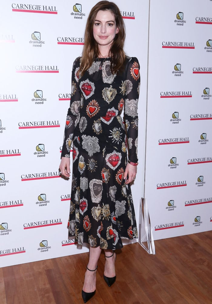 Anne steps out in a midi dress with eccentric prints from Dolce & Gabbana's Spring 2018 collection