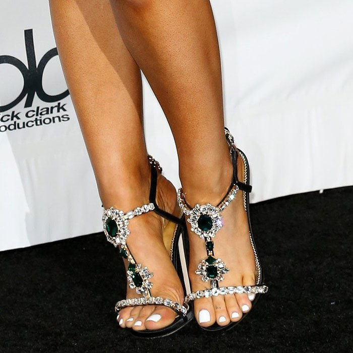 Closeup of the Dsquared2 'Queen Mary' jeweled t-strap sandals on Ariana Grande.