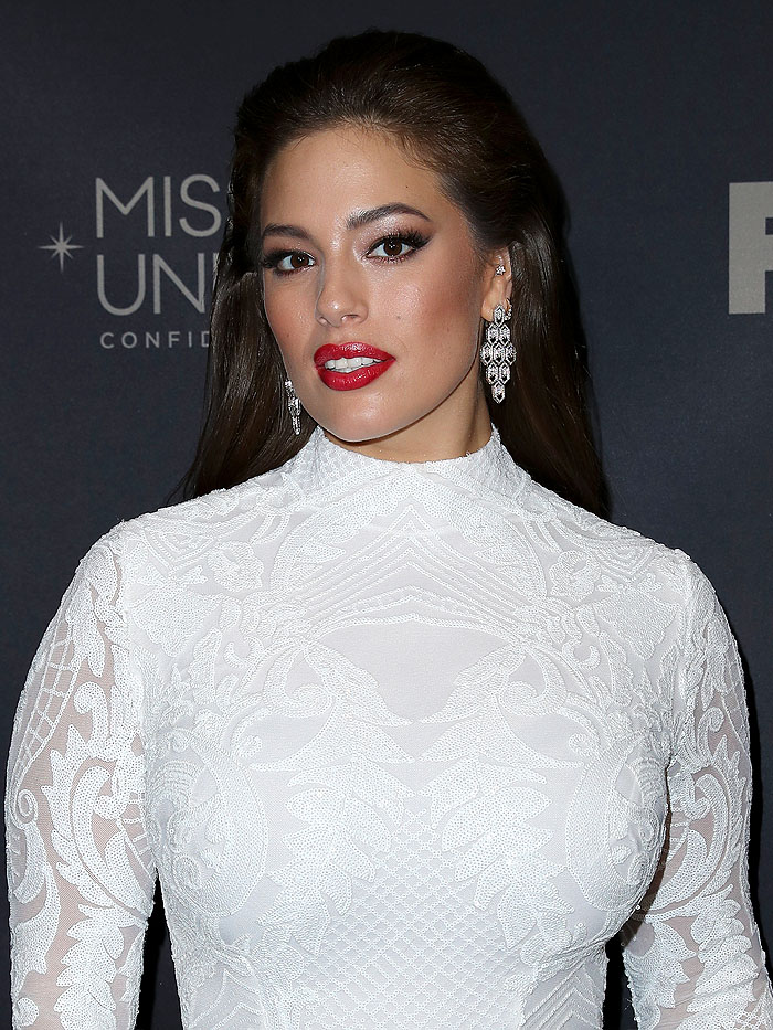 Ashley Graham styled her look with a brushed-back hairdo, standout red lips and stunning Bulgari chandelier earrings