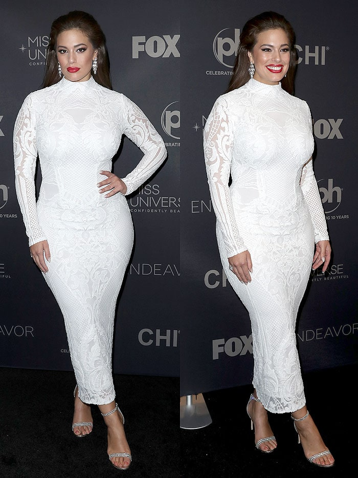Ashley Graham put her famous curves on display in a tight, white Michael Costello embroidered-lace gown but kept things elegant with the modest high neckline and long sleeves