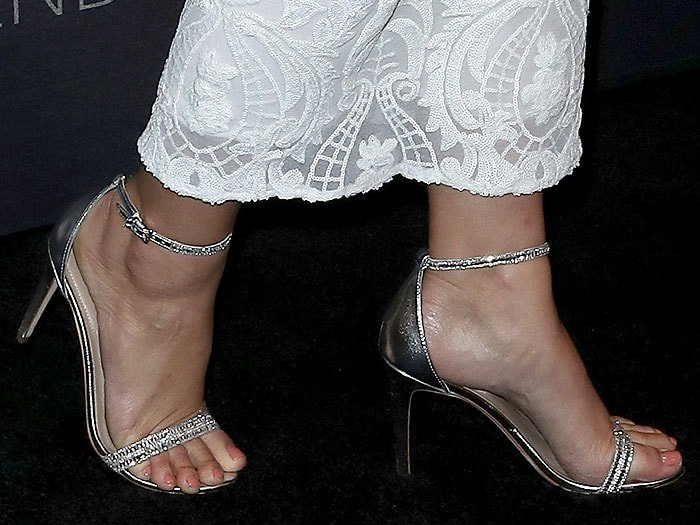 Ashley Graham's silver ankle-strap sandals with sparkling details on the straps up close.
