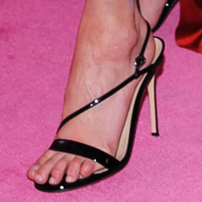 "Bella complements her dark locks with a pair of Gianvito Rossi ""Manhattan"" sandals in black patent"