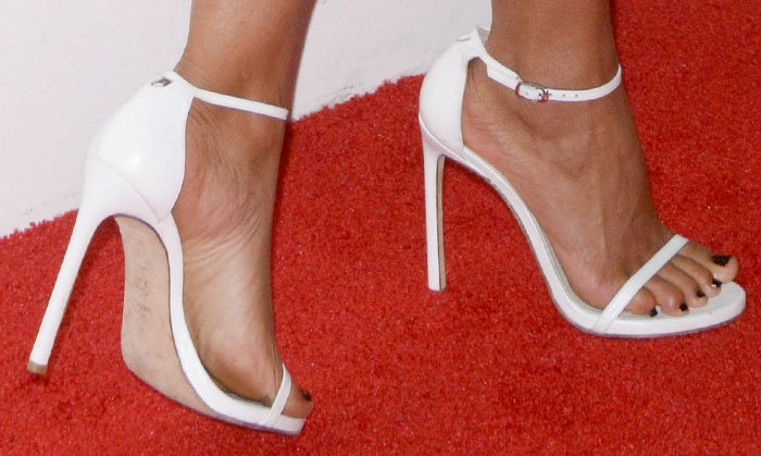 "The actress stuck to the classics in a white pair of Stuart Weitzman ""Nudist"" sandals"