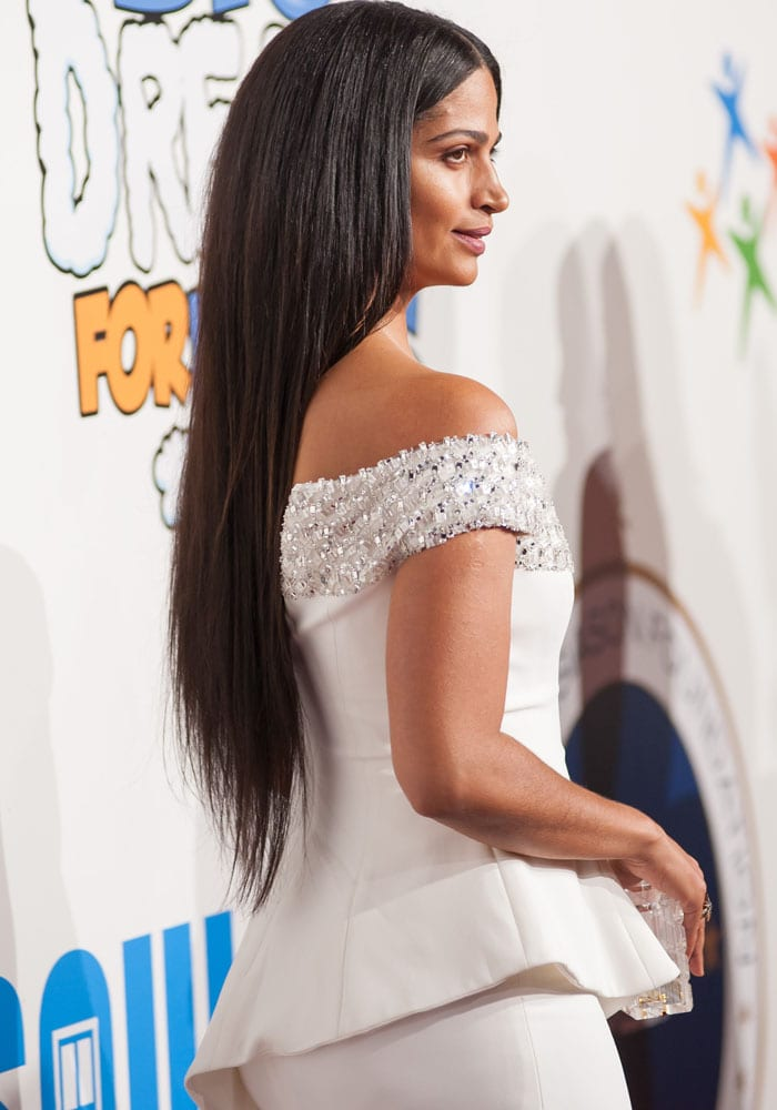 Camila shows off the details of her Pamella Roland embellished top