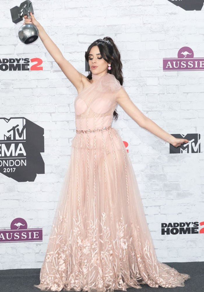 Camila Cabello poses with her Best Pop Award trophy at the MTV EMAs
