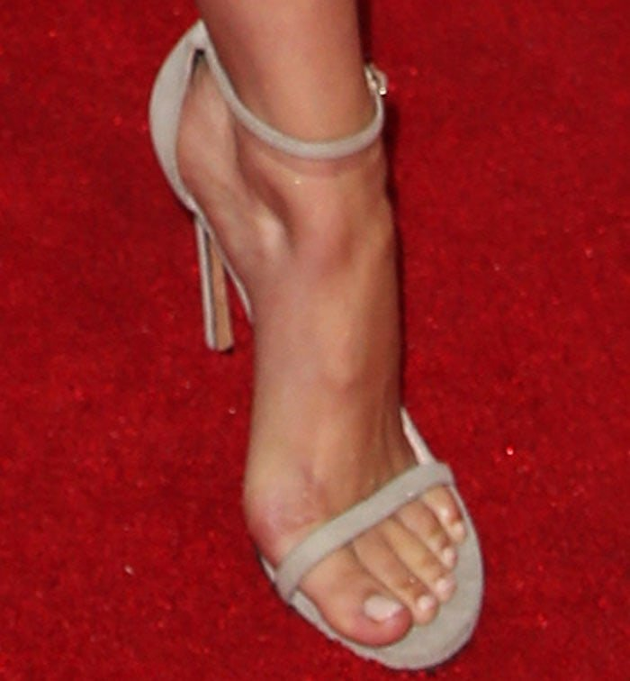 "The actress inserted neutrals with a pair of Stuart Weitzman ""Nudist"" sandals"