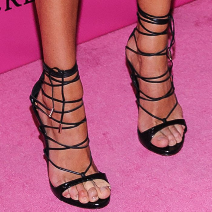 "Candice added lines to her look with a pair of DSquared2 ""RiRi"" sandals"