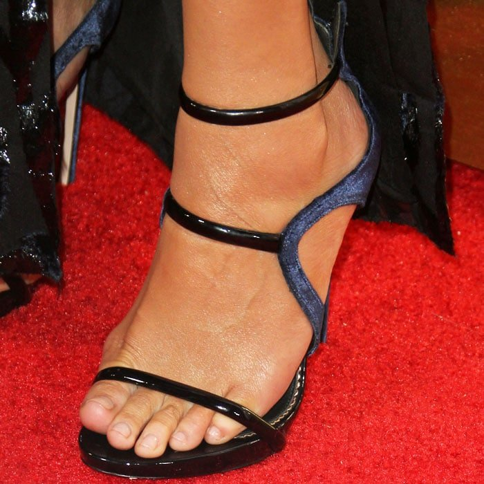Chrissy stepped onto the red carpet in a pair of strappy patent sandals