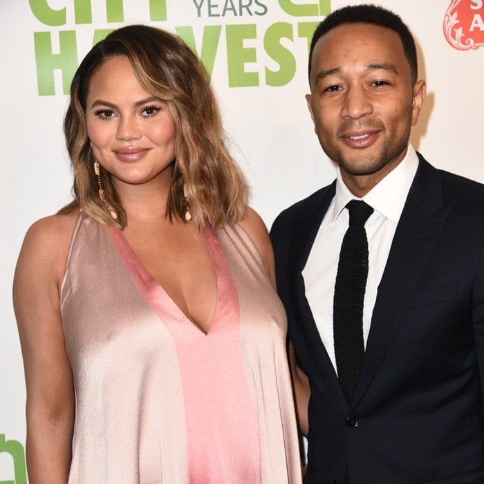 Chrissy Teigen and John Legend are all smiles as they arrive at the 2018 City Harvest Gala at Cipriani's in New York City on April 24, 2018