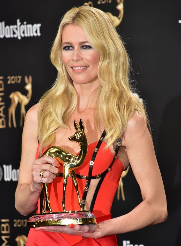 Claudia Schiffer holding up her shiny new Bambi Award at the ceremony held at the Stage Theater in Berlin, Germany, on November 16, 2017