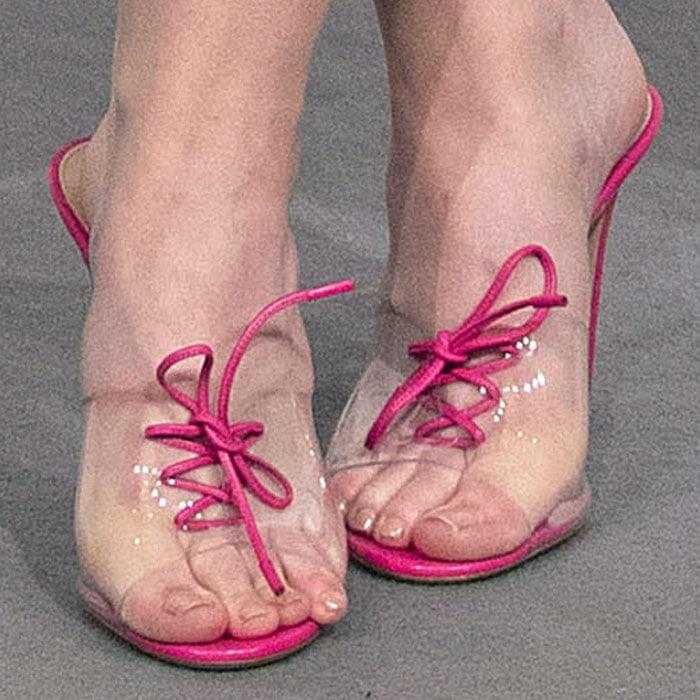 "Dakota wears a playful pair of Gianvito Rossi ""Plexi Corset"" mules"