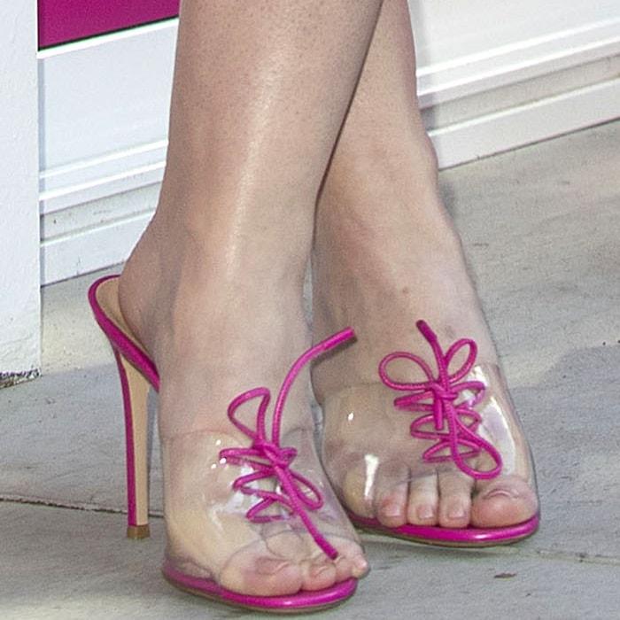 "Dakota picked out the pink Gianvito Rossi ""Plexi Closet"" pair to complete her ensemble"