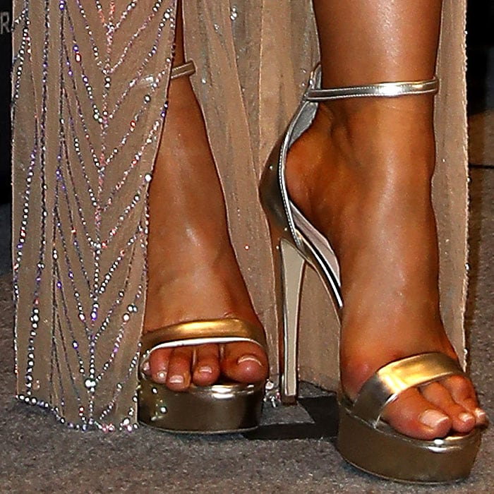 Details of Miss Universe 2017 Demi-Leigh Nel-Peters' gold ankle-strap platform sandals.