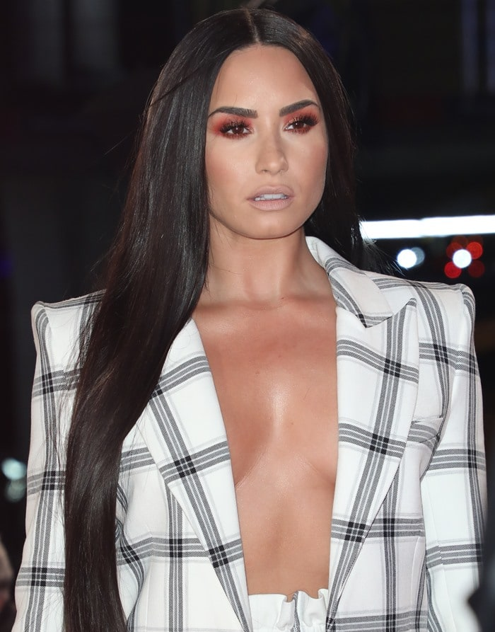 Demi Lovato wearing a Styland suit at the 2017 MTV EMAs red carpet at The SSE Arena in Wembley in London, England, on November 12, 2017