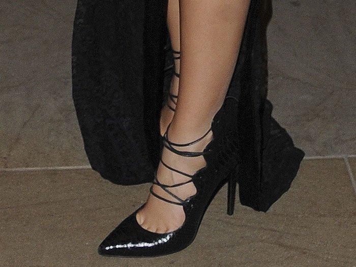 """Details of Demi Rose's Saint Laurent """"Paris"""" python-embossed lace-up pumps."""