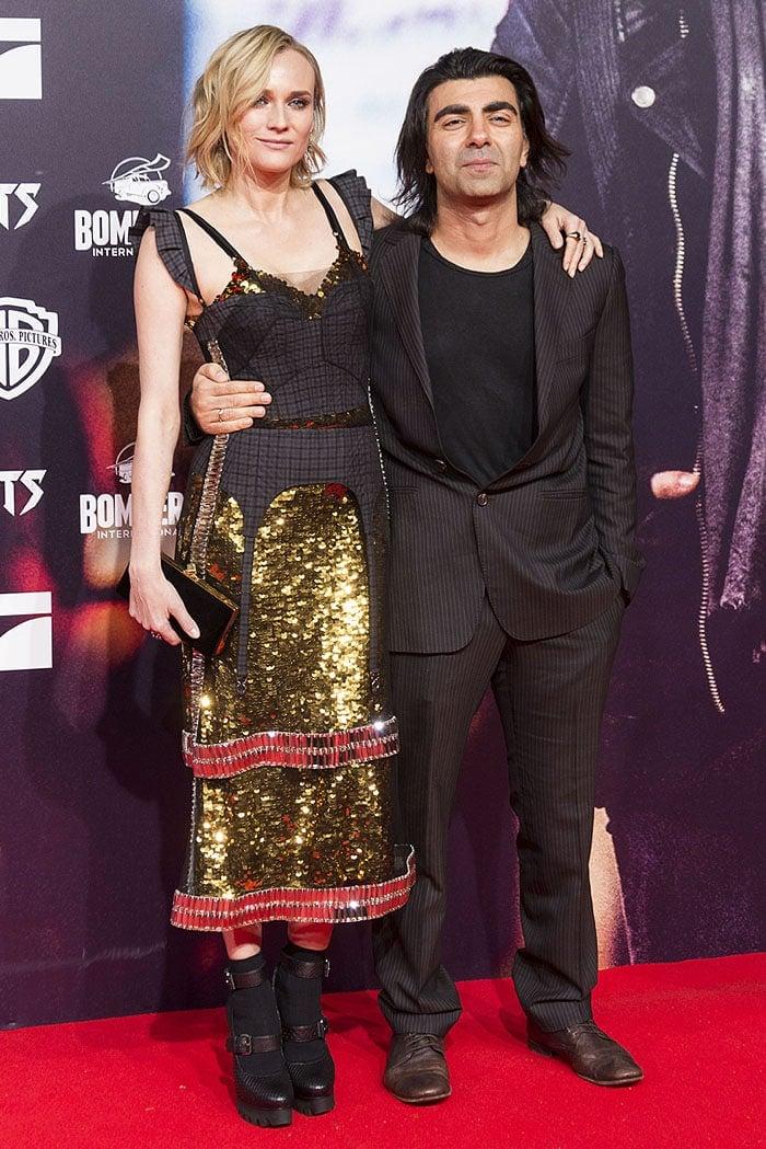 Diane Kruger posing with writer-director Fatih Akin on the red carpet.