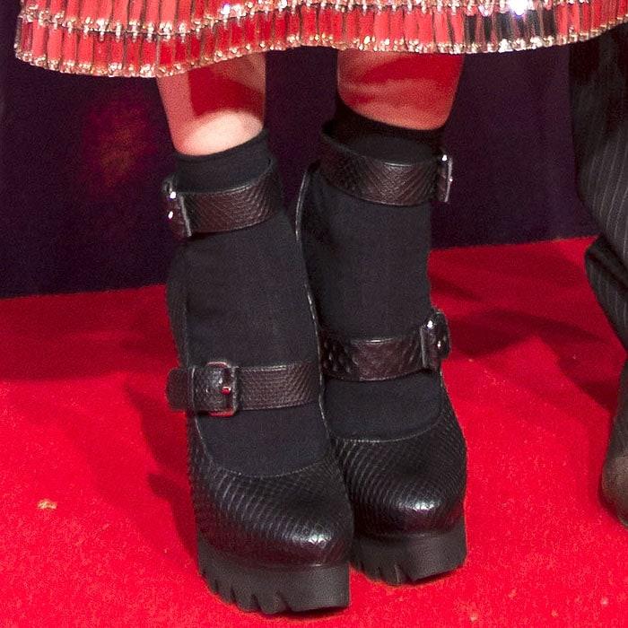 Closeup of Diane Kruger's double-buckled, snake-embossed, lug-sole platform pumps.
