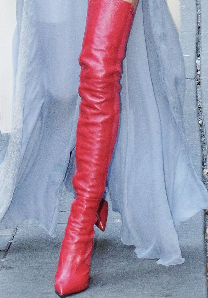 "Elsa contrasts her feminine look with a pair of leather thigh high Fendi ""Rockoko"" boots"