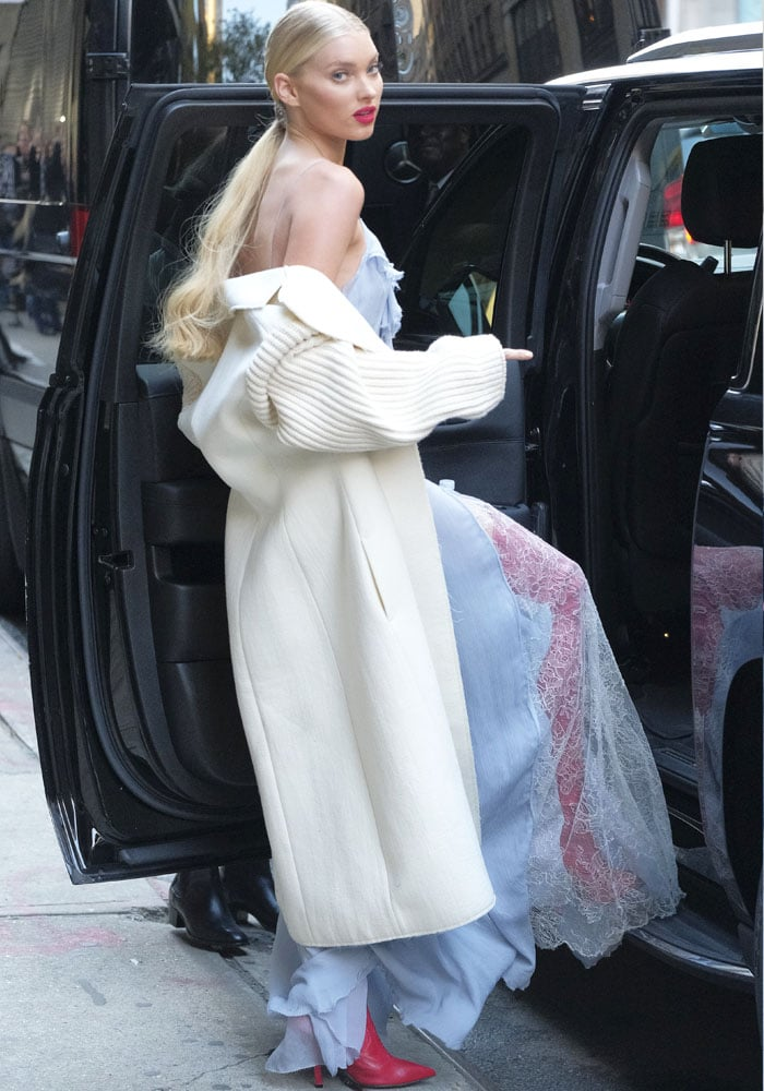 Elsa climbs into her car before heading out to promote the Victoria's Secret Show