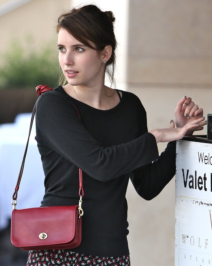 Emma Roberts toting a cute red Coach Legacy leather 'Penny' shoulder purse