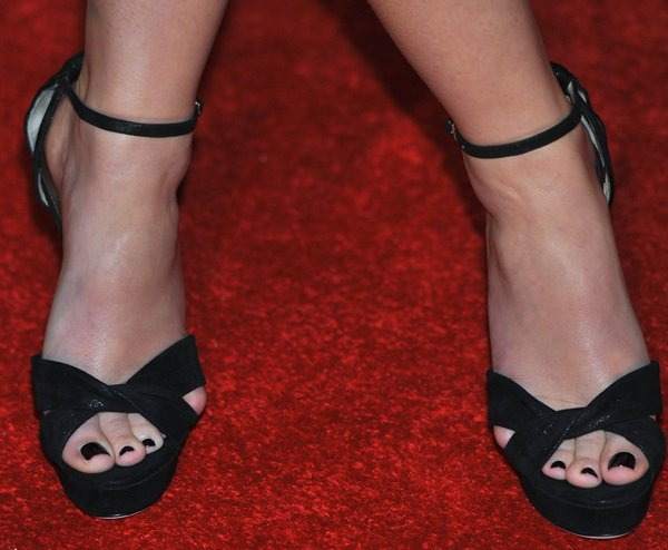 Emma Watson wearing black Jimmy Choo pumps