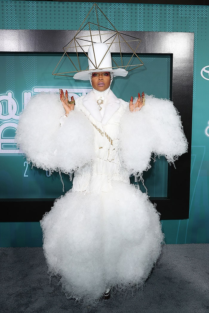 Erykah Badu finished her avant garde ensemble with a metal chain dangling from her mouth and odd gold-and-rust paint stains on her fingertips